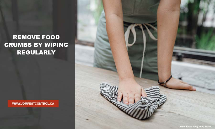 Remove food crumbs by wiping regularly